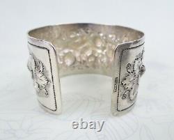 Big sterling silver heavy floral repousse antique cuff bracelet